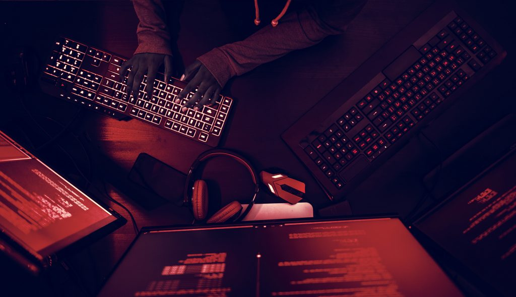 Hacker working on computer cyber crime